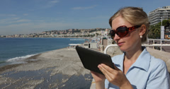 Ultra HD 4K Blonde Woman Using Digital Tablet Nice French Riviera Cote D'Azur Stock Footage