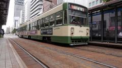 Streetcars at Chudenmae Station in Hiroshima Stock Footage