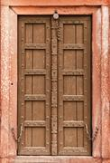 Old wooden door - part of indian architecture Stock Photos