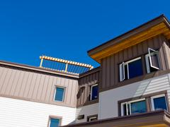 Timber clad condo building exterior upper storey Stock Photos