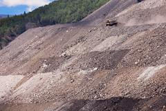 Mining truck on haul road at tailings hill side Stock Photos