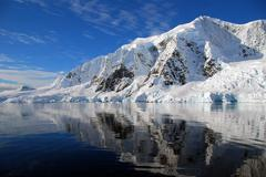 Stock Photo of antarctic continent with mirror reflection