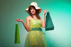 young spring woman with shopping bag - stock photo