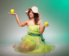 beautiful spring woman with apple. green concept - stock photo