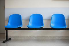 Waiting room blue chairs door Stock Photos