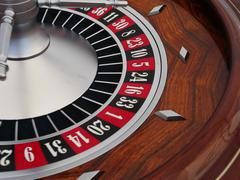 playing with chips at a roulette table - stock photo
