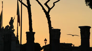 Stock Video Footage of Sunset Roma, silhouette columns & statues 2