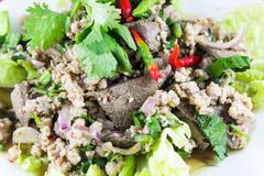 Thai cuisine larb moo spicy minced pork salad Stock Photos