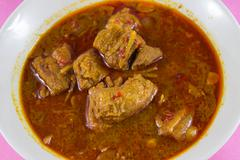 gang hang lay  traditional burmese pork curry with ginger - stock photo