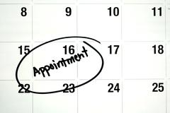 Word appointment circled on calendar Stock Photos