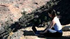 Woman Working Remotely on Laptop in the Mountains Stock Footage