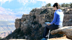 Woman Working on Tablet in the Mountains Stock Footage
