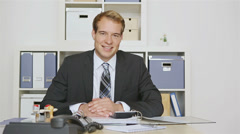 Business man holding thumbs up Stock Footage