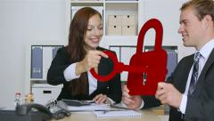 Business people holding key and lock Stock Footage
