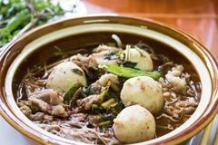 Kuay teow nam tok moo (waterfall noodles) ; wide rice noodlesoup with vegetab Stock Photos