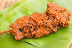 fried chicken on banana leaf thailand style - stock photo