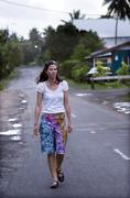young woman travels in tropical town. - stock photo