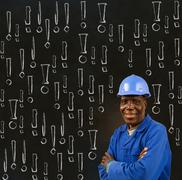 African american black man worker with chalk safety warning exclamation marks Stock Photos