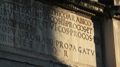 Light hitting ancient Roman writing Stock Footage
