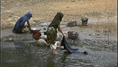 Washing Clothes in River AFGHANISTAN 1980s Vintage Film Home Movie 7130 - stock footage