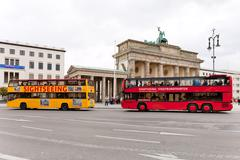 Two tourist double decker buses in berlin Stock Photos
