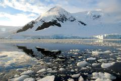 antarctic landscape, reflected in water - stock photo