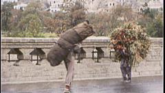 Men Carry Wood Bundle AFGHANISTAN Kabul 1980s Vintage Film Home Movie 7133 Stock Footage