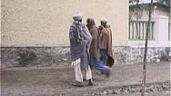 Stock Video Footage of Tribal Men AFGHANISTAN Kabul Street Scene War 1980s Vintage Film Home Movie 7135