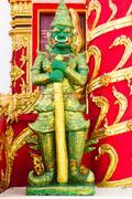 Giant guarding statue at temple thailand, ancient decorative door of thai tem Stock Photos