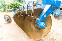 rusted hard disc harrow, outdoor, close up - stock photo