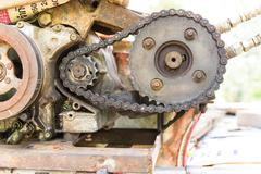 old and rusty cogwheels with chain - stock photo