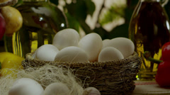 Stock footage golden egg among ordinary chicken eggs Stock Footage