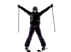 One woman skier skiing arms outstretched happy silhouette Stock Photos