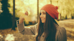 Girl in Autumn playing with Maple Leaf in Park with vintage color correction - stock footage