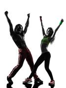 Couple man and woman exercising fitness zumba dancing silhouette Stock Photos