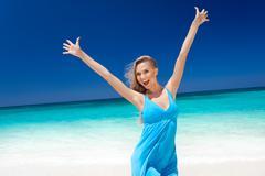 Happy blond girl on beach, feeling freedom. Stock Photos