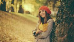 Girl in Autumn playing with Leaf in Park with vintage color correction - stock footage