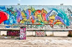 Graffiti on Mauerpark wall in Berlin - stock photo