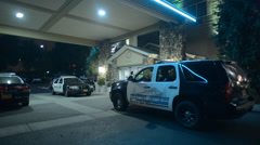 Police Cars Parked Infront Of A Hotel At Night Stock Footage