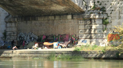 Homeless - living under a bridge - stock footage