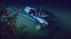Submerged Truck At Night - stock footage