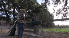 Cowboy, ranch hand putting on gloves Stock Footage