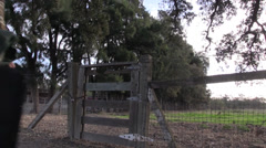 Cowboy rancher at gate Stock Footage