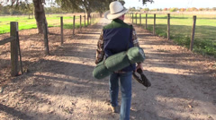 Cowboy bedroll and rope Stock Footage