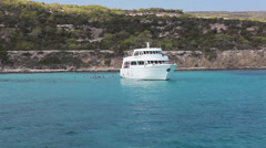 Recreational marine boat with glass bottom is in the blue lagoon Stock Footage