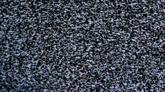 TV screen with no signal and white noise or static snow noise - stock footage