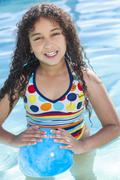 african american mixed race girl child in swimming pool - stock photo