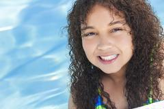African american mixed race girl child in swimming pool Stock Photos