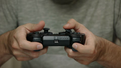 Young Man Plays Video Game With Black Controller Stock Footage