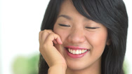 Stock Video Footage of Close up of Asian woman smiling with hand on cheek